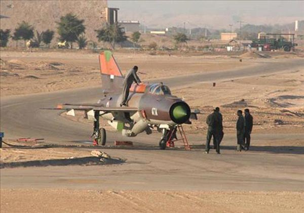 A Syrian MiG-21 fighter plane is seen after the pilot landed at the King Hussein military air base