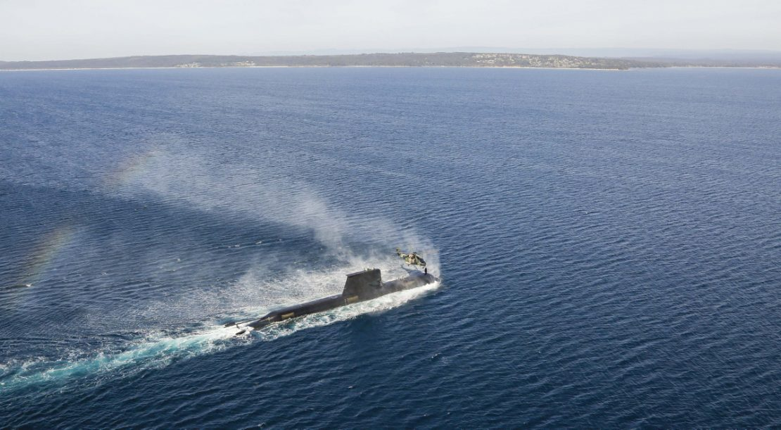Australian Submarine and MRH-90 conduct personnel transfer